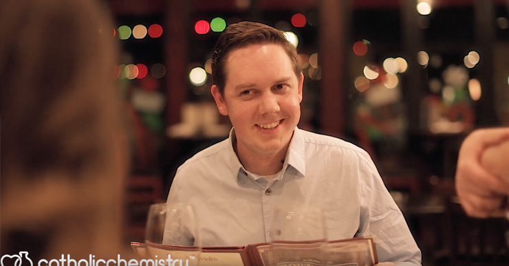 man on date leaning in with smile